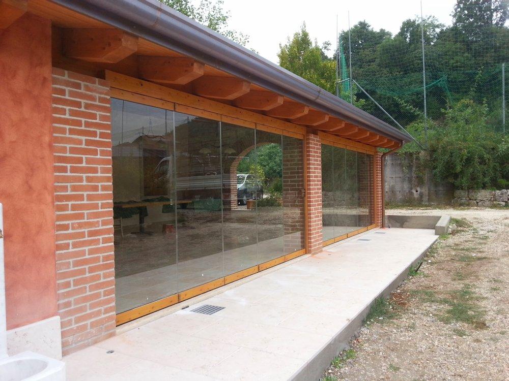 Terrazzo Con Vetrata: Terrazzo con vetrata folding doors for sun room.
