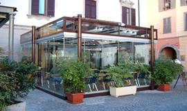 Le verande i porticati le pergole gm morando for Balcone chiuso da vetrate